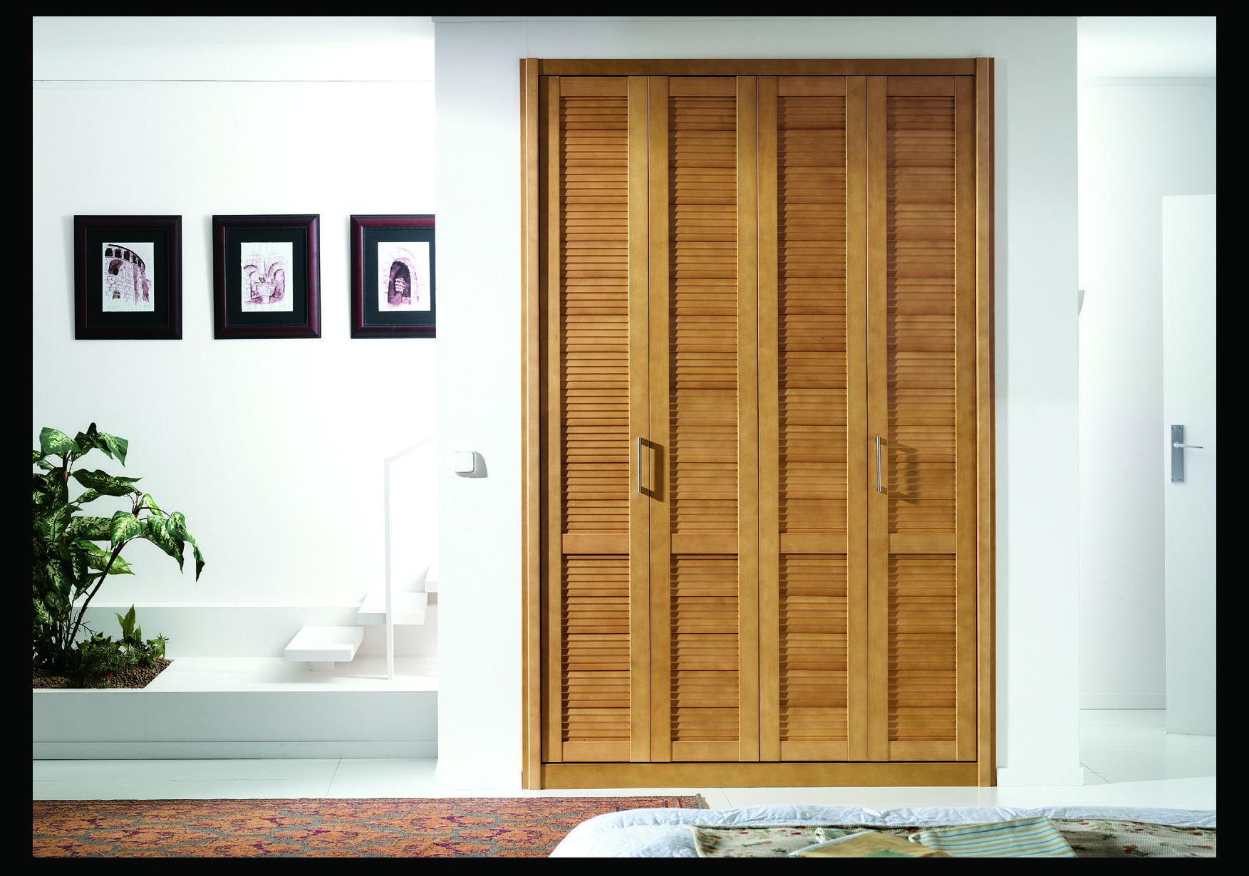 Armarios de puertas plegables correderas for Cortinas para puertas de armarios