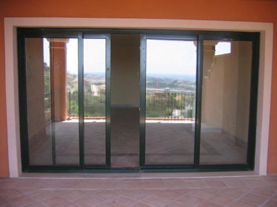 Puertas de aluminio para terrazas great afandecor for Puertas de terraza de aluminio