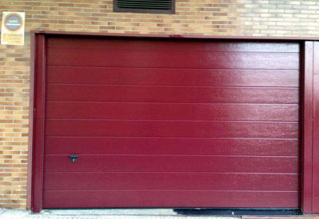 Reparaci n de puertas de garaje en oviedo automatismos el for Portones de garaje