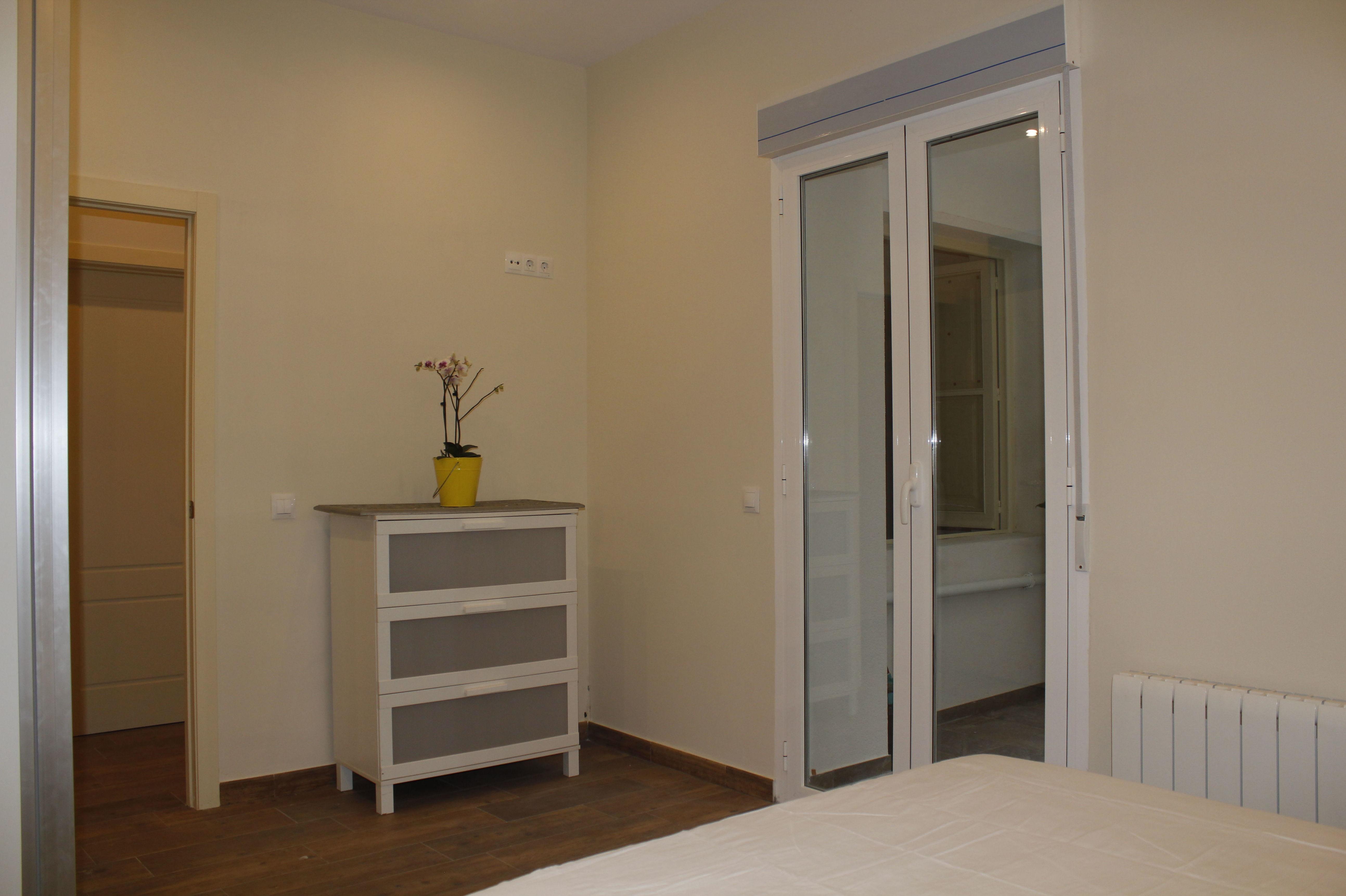 Dormitorios reformado por Maela Interiorismo