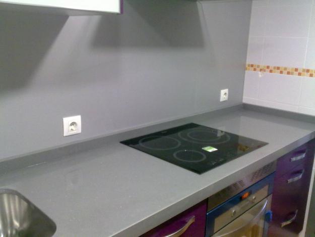 Encimera negro gris plomo cemento niebla etc for Encimera de granito gris