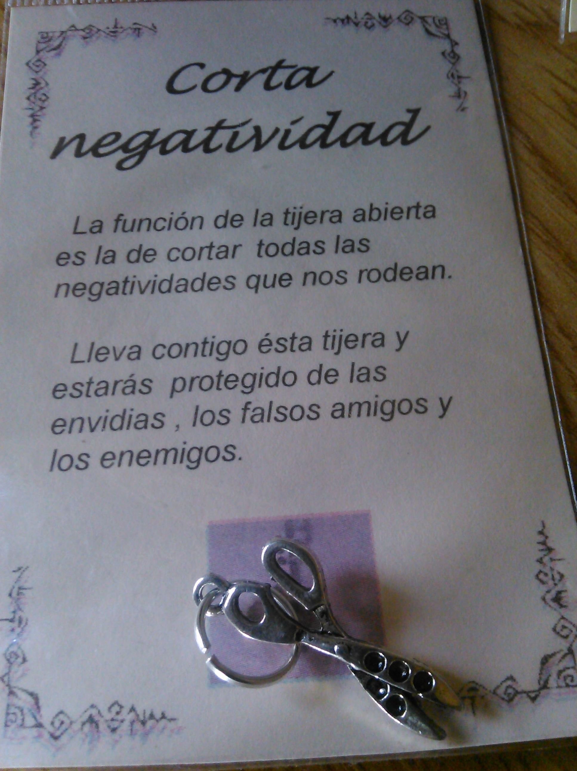 corta negatividad, amuleto tijera