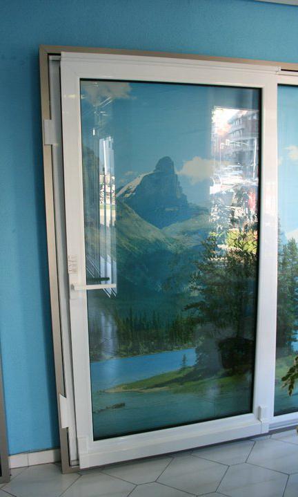 Puerta osciloparalela servicios de ventanas arsan for Puerta osciloparalela