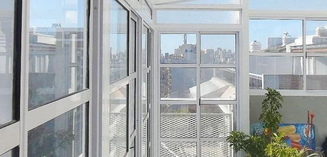Carpintería de aluminio y cerramientos de terrazas en Chamberí