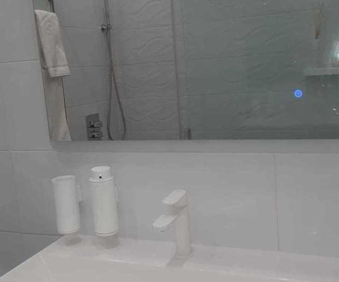 Reforma Integral de Baño con suelo radiante y  iluminación ambiente