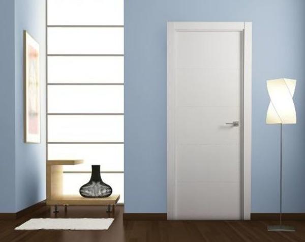 Puertas lacadas en Blanco y con una sutil ranura en V.