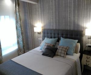 Dormitorio principal con un estilo clásico actualizado