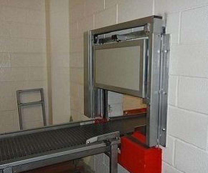 Puerta guillotina cortafuegos en cinta transportadora discontinua