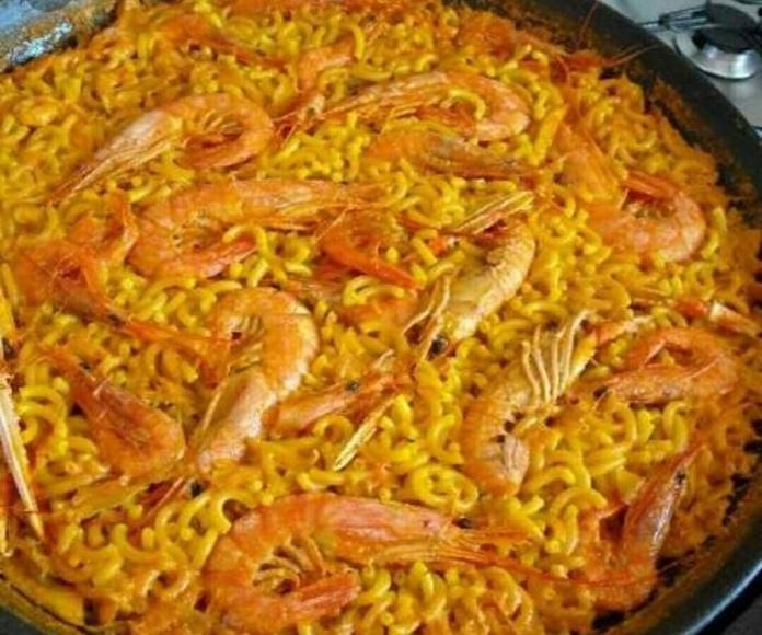 Paellas y arroces a domicilio: Comidas para disfrutar de Guisando Comida para Llevar
