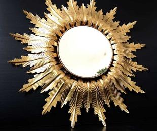 Espejo sol de forja y pan de oro