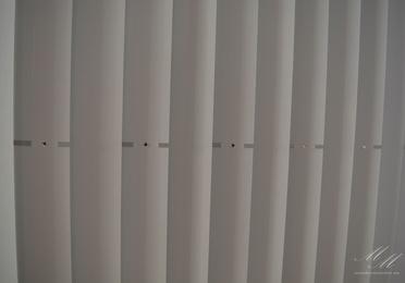 Estores enrollables y cortinas verticales