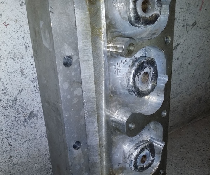 recargue pieza de aluminio mal mecanizada