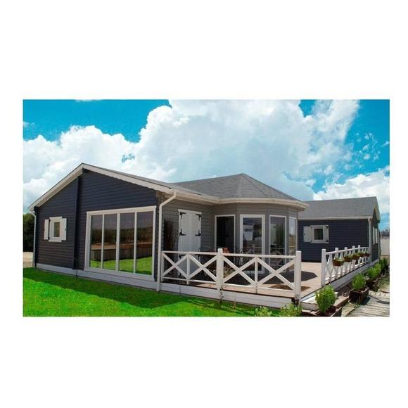 Lorena (150 m2): Casas de madera de 5SCC Casas de Madera