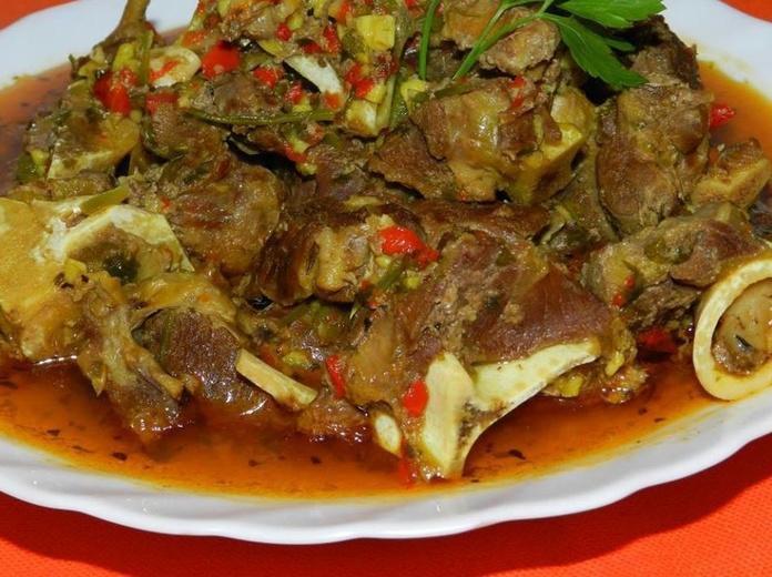 Carne de cabra en adobo: Pollo asado y comida casera de Asadero de pollos Jerusalén