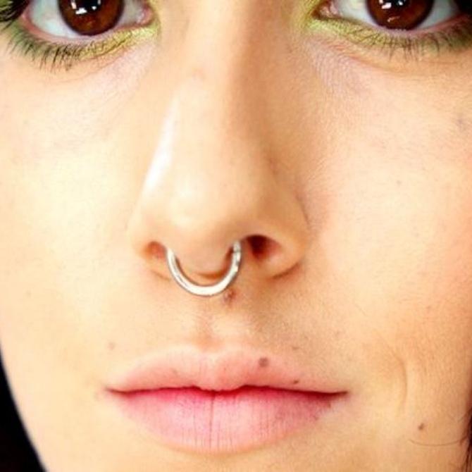 Qué es el piercing septum