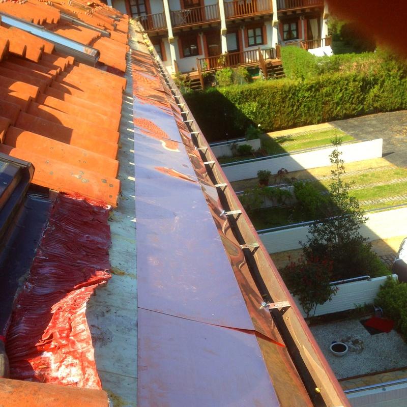 Instalación de canalón y lima de cobre.