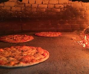 Pizzas en el horno en Sitges