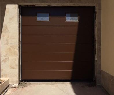Puerta Seccional Ral 8014 imitación piel