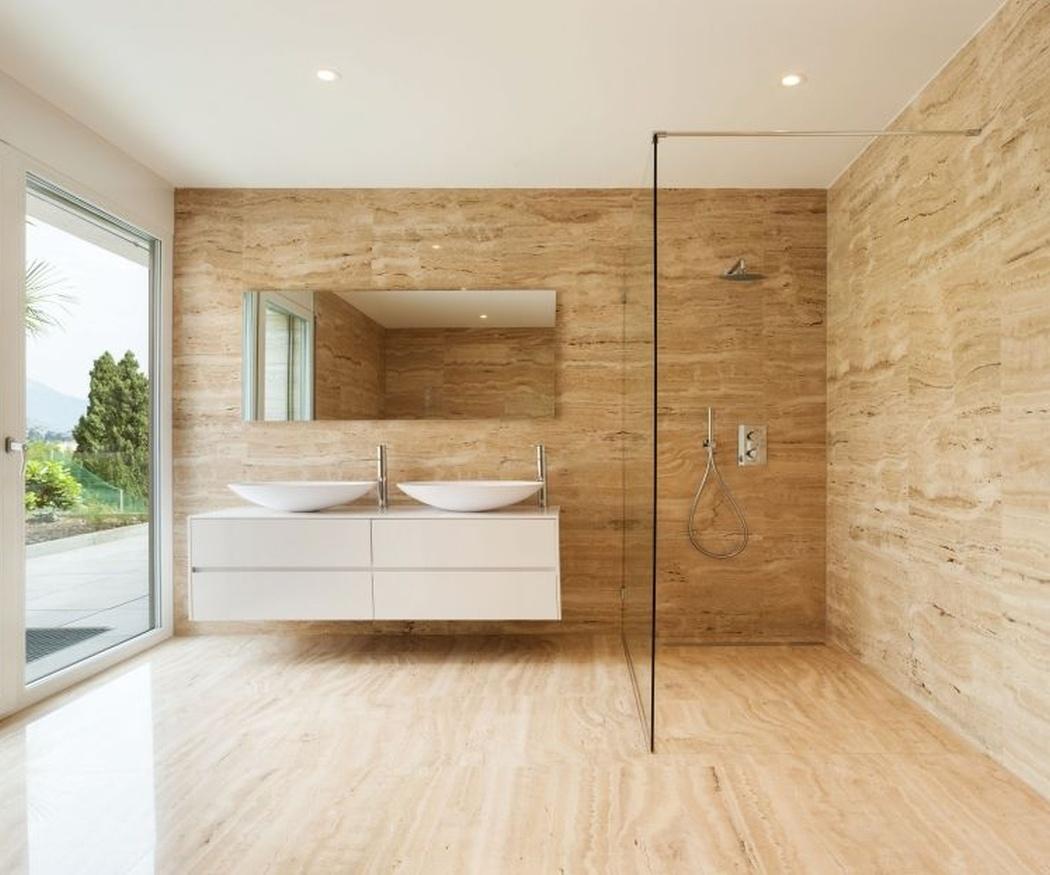 Una fórmula para ganar espacio en el baño: sustituir la bañera por una ducha