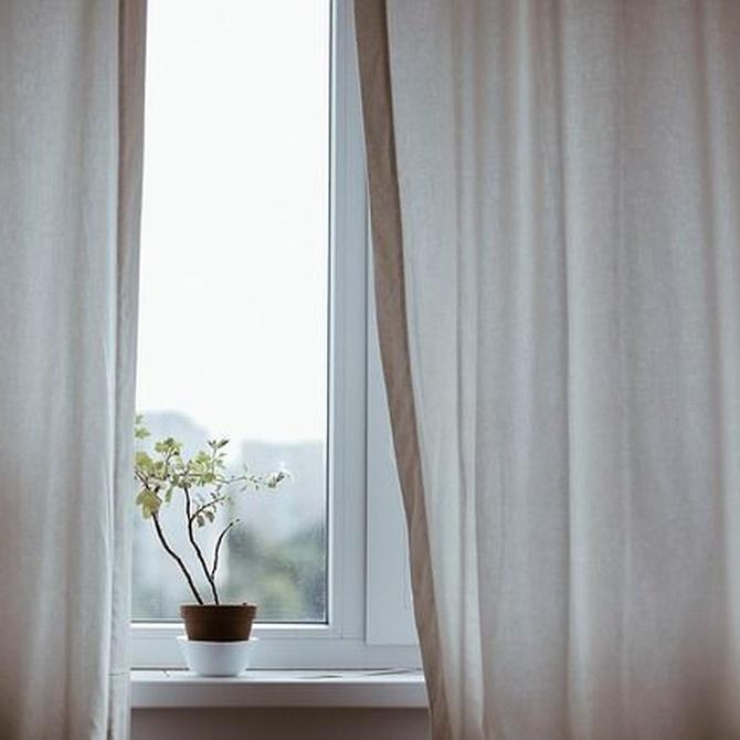 Poner una cortina, una manera de dotar de personalidad a tu casa