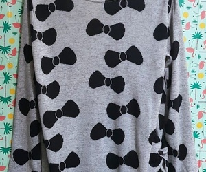 Camiseta oversize de lazos negros