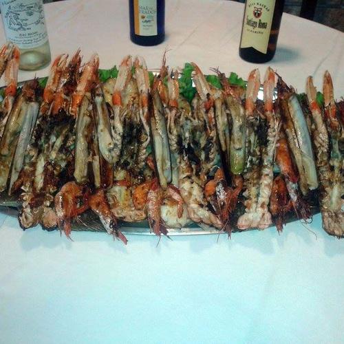Especialidad en parrilladas de marisco y pescado