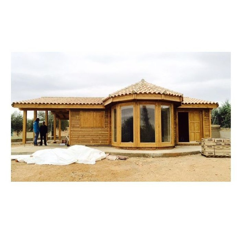Daniela Porche (101 m2): Casas de madera de 5SCC Casas de Madera
