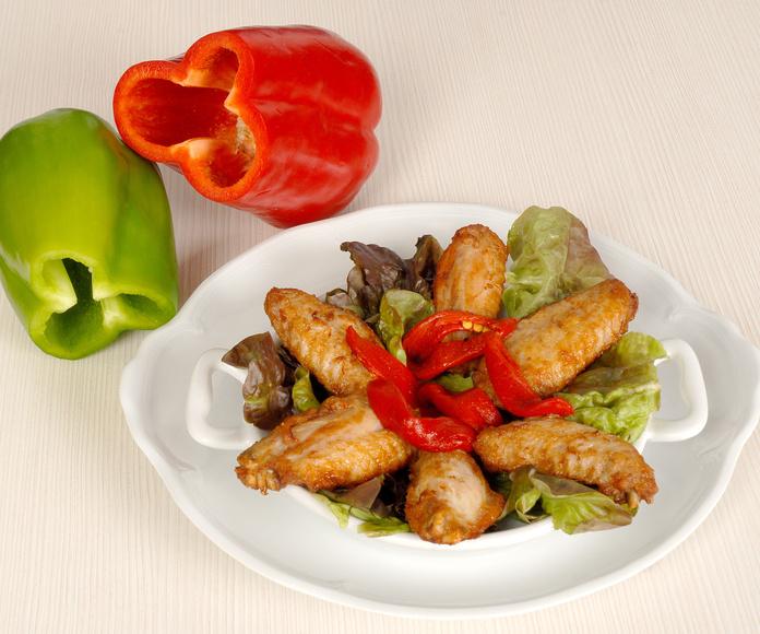 Alitas de pollo con pimientos