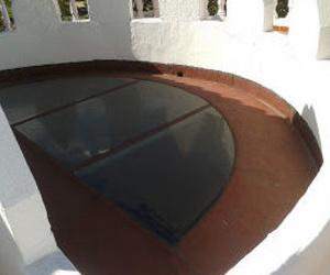 Tela asfáltica sobre cristal