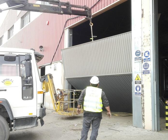 montaje puerta basculante pre leva golpeada ROMANI Valencia