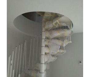 Hueco de escalera espiral en pladur