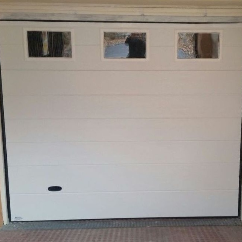 Puertas seccionales residenciales: Productos de Veinser