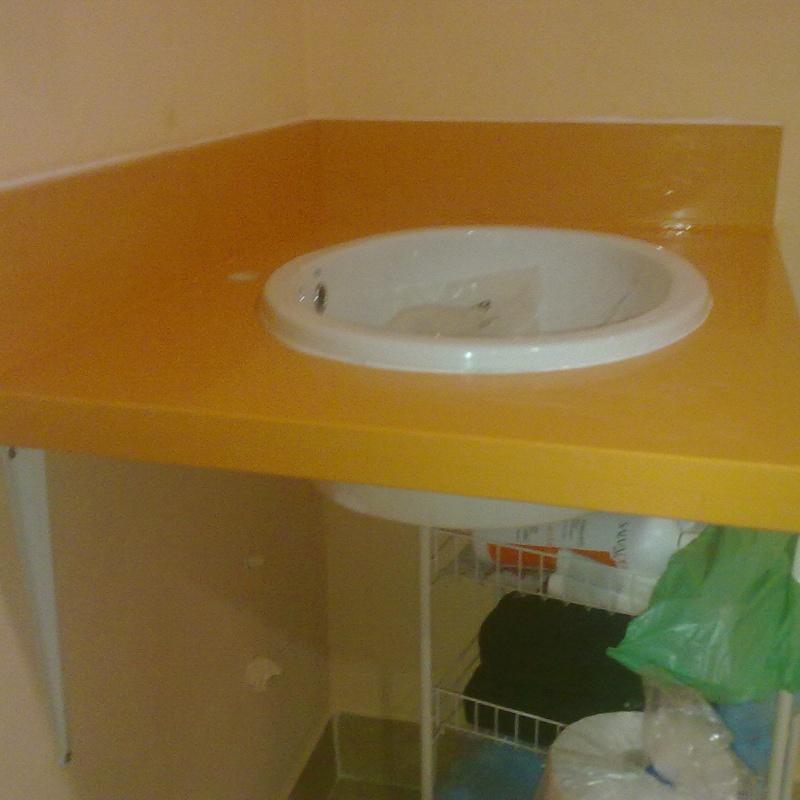 Encimeras(naranja,amarillo,etc): Catálogo y exposición de Alcomármol