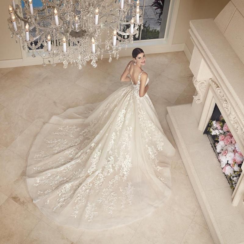 Trajes de novia: Ceremonia y comunión de Eros Boutique Nupcial