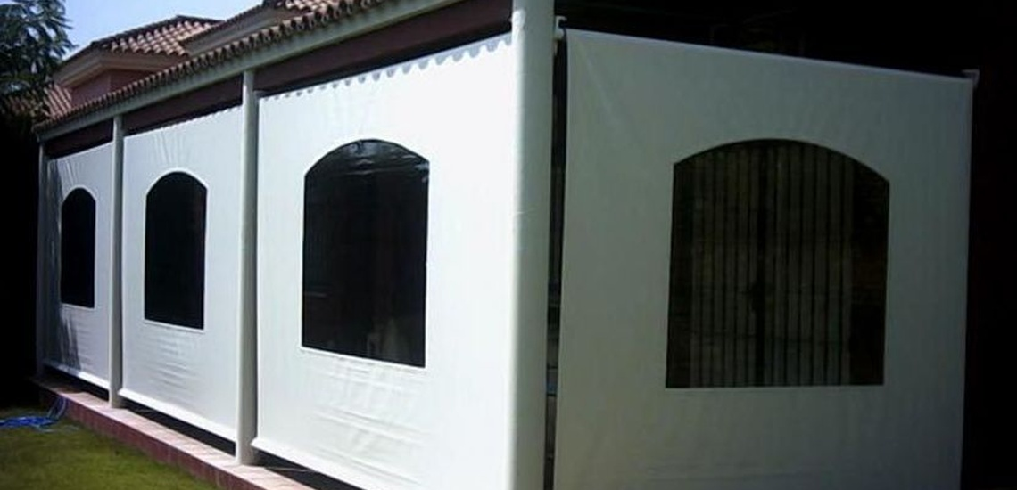 Pérgolas baratas en Valencia y cerramientos con toldo cortavientos