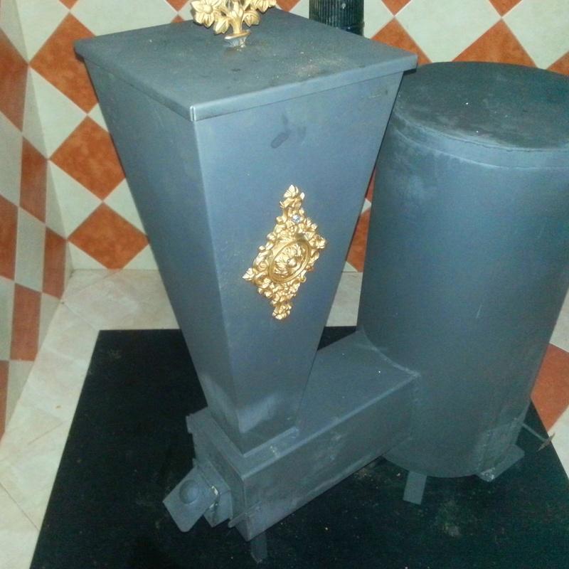 Estufa mixta de *Biomasa  y leña: NUESTROS PRODUCTOS de Grupo Medina