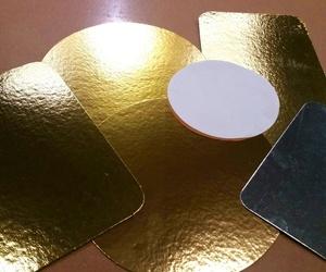 Bandejas y discos de cartoncillo laminado, para alimentación. Además de discos de celulosa y Kraft