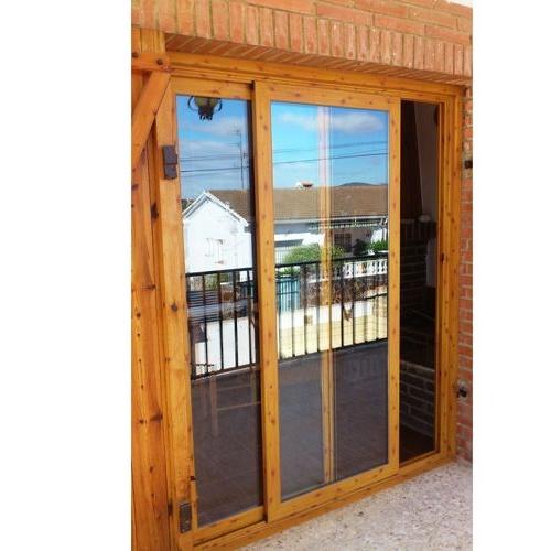 Puertas de terraza imitando a madera