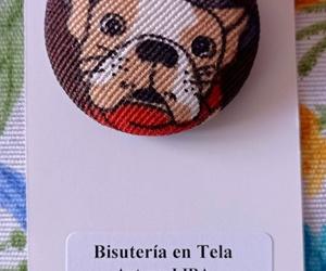 Broche con carita de perro. Bisutería en tela de Lira.