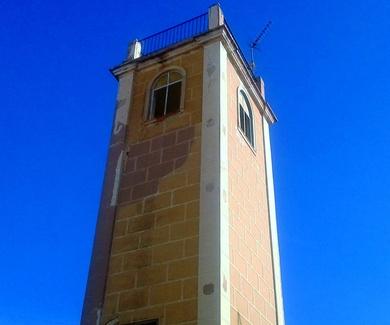 RESTAURACION DE UNA TORRE CON CORCHO PROYECTADO EN ROCAFORT ( VALENCIA