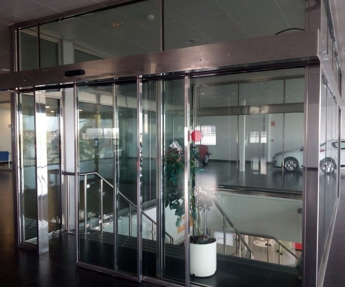 Puertas correderas telescópicas INOXIDABLE y cristal