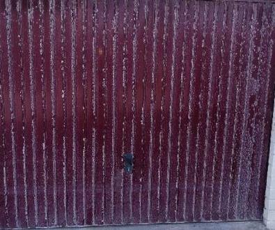 Reparación de puerta basculante
