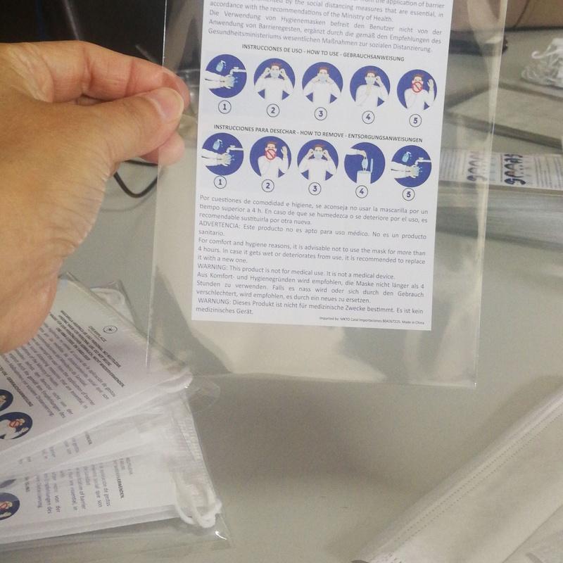 Prepados de mascarillas con pegatina e indicaciones