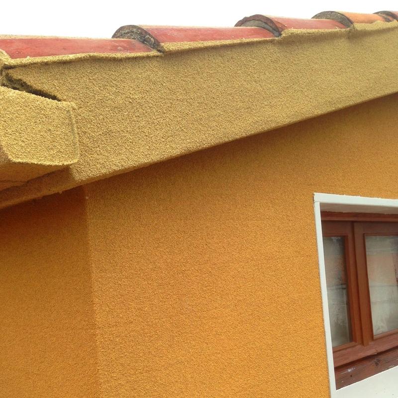 Aislamiento de fachadas proyección de corcho.