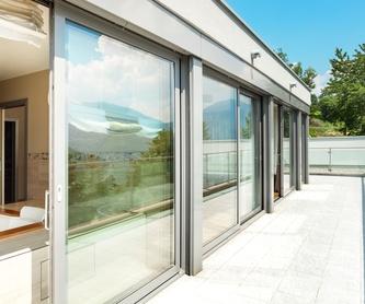 Puertas de garaje: Servicios de Cristalería Hierro y Aluminios Rafa