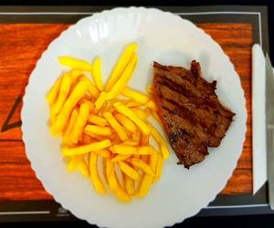 Vacío con patatas fritas