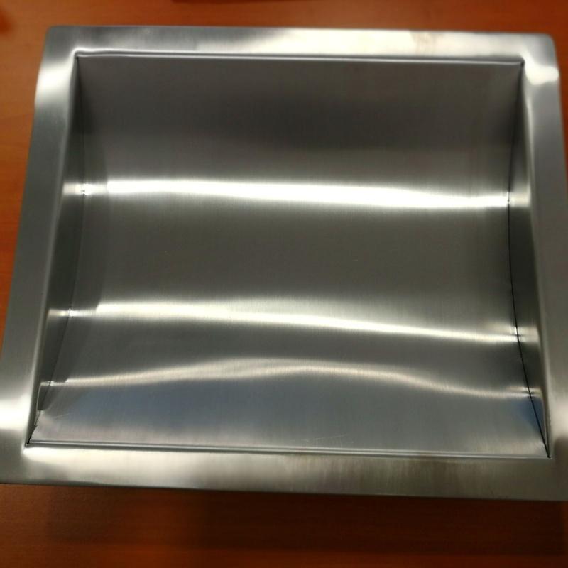 Pasamonedas de acero inoxidable integrable para mostrador de comercios.