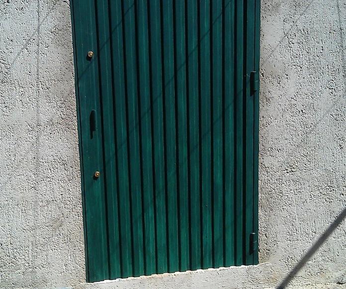 Puerta de hierro de 1 hoja abatible con chapa pegaso