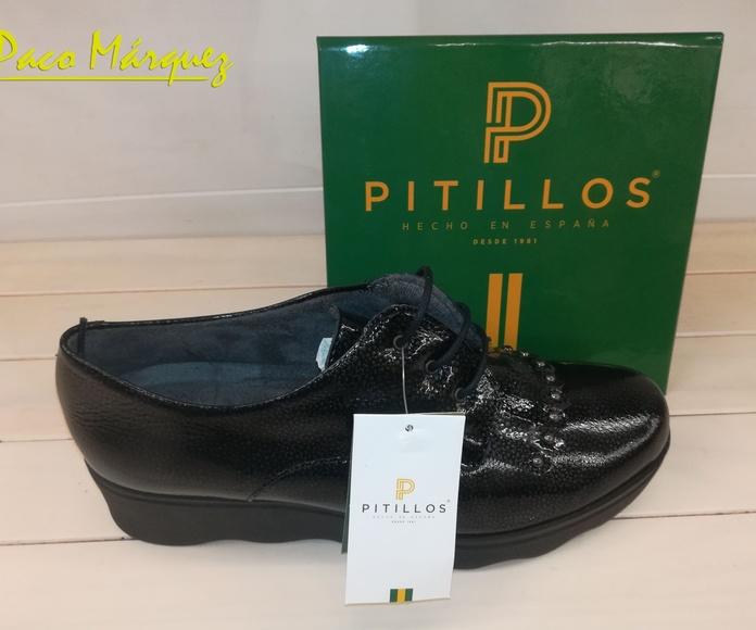 Zapatos negros con tachuelas