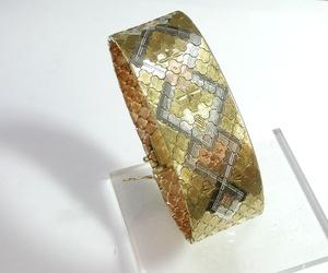 Pulsera realizada en oro tricolor de 18k. Circa: 1960.